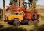 Лесовозный автопоезд Урал с гидроманипулятором
